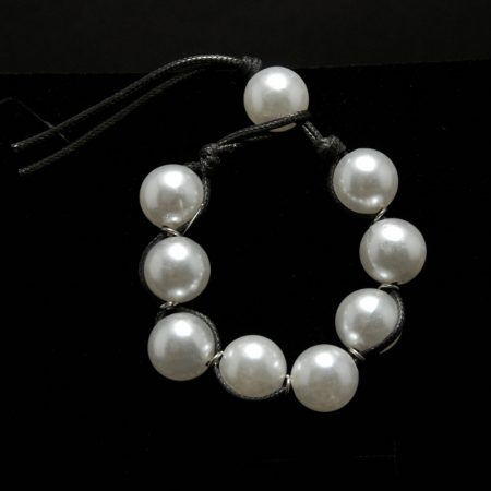 Handmade bracelet with big pearls and black leather
