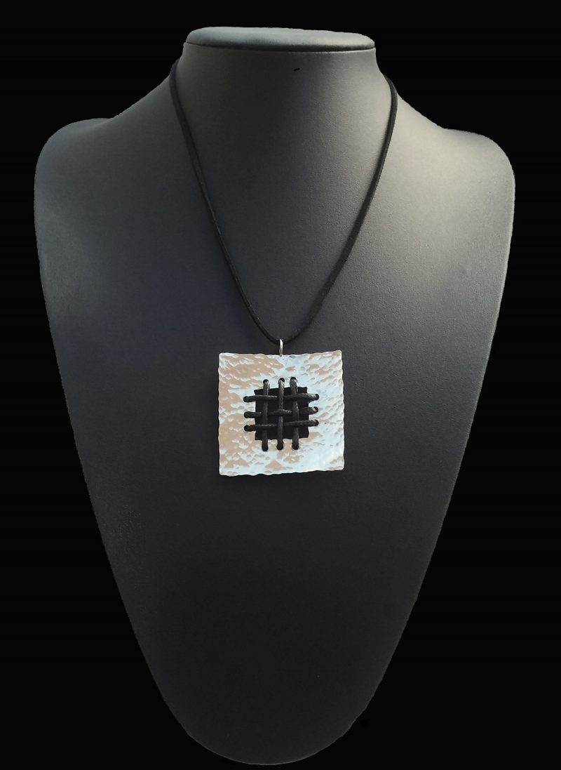 Handmade necklace with hammered arzanto [alpaca] and black leather!