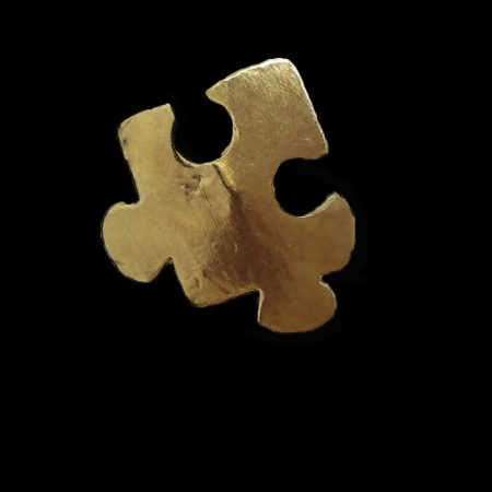 Handmade ring in plan puzzle piece with brass