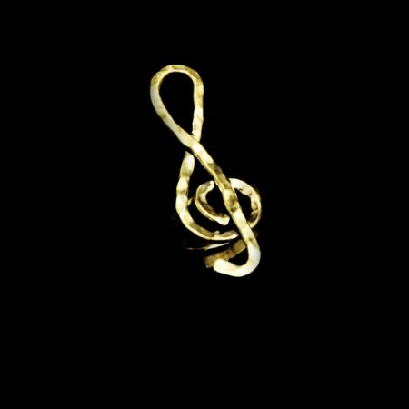 Handmade ring in plan treble clef with hammered brass
