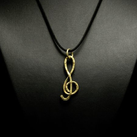 Handmade pendant with treble clef and hammered brass
