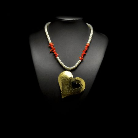 Handmade necklace with big heart made of hammered brass, pearls and semi-precious stones corals