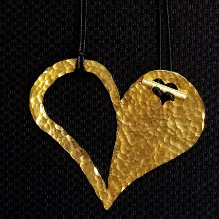 Handmade heart pendant with hammered brass!