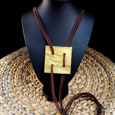 Handmade hammered  brass  with suede cords