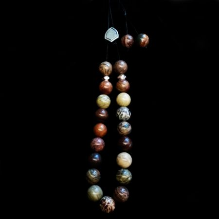 Handmade rosary with semi-precious stones and metallic element!